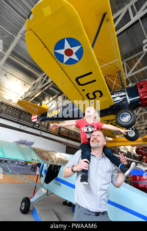 USA Maryland MD Prince Georges County College Park Aviation Museum father and son viewing antique aircraft at the oldest airport in the world - Stock Image