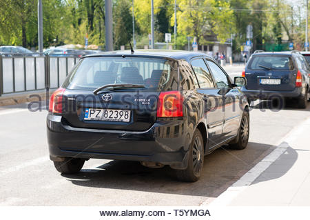 Poznan, Poland - April 18, 2019: Parked black Toyota Corolla car on a white marked parking spot in the city center. - Stock Image