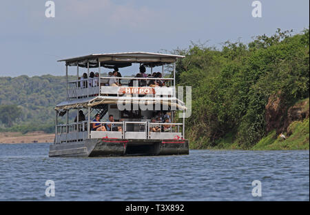 tourist boat in the Kazinga channel  Queen Elizabeth National Park, Uganda.     November - Stock Image