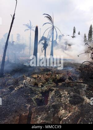 Leilani Estates, Hawaii. May 9, 2018. Massive ground cracks vent steam and poison gases after fissure 14 opened from the Kilauea volcano eruption May 9, 2018 in Leilani Estates, Hawaii. The recent eruption continues destroying homes, forcing evacuations and spewing lava and poison gas on the Big Island of Hawaii. Credit: Planetpix/Alamy Live News - Stock Image