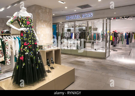 New York, 3/11/2019: Dresses and other clothing items are put on display at the Michael Kors section at Bloomingdale's department store in Manhattan. - Stock Image