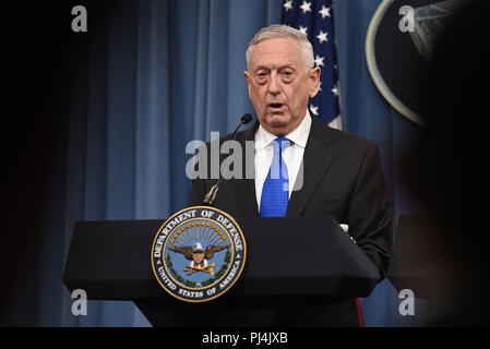 U.S. Secretary of Defense James N. Mattis speaks at a joint press conference with the chairman of the Joint Chiefs of Staff, Marine Corps Gen. Joseph F. Dunford, the Pentagon, Arlington, Va., Aug. 28, 2018. DoD photo by Lisa Ferdinando - Stock Image