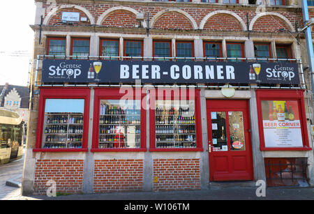 The outside of a beer store in Ghent. Large amounts of beer can be seen on display . - Stock Image