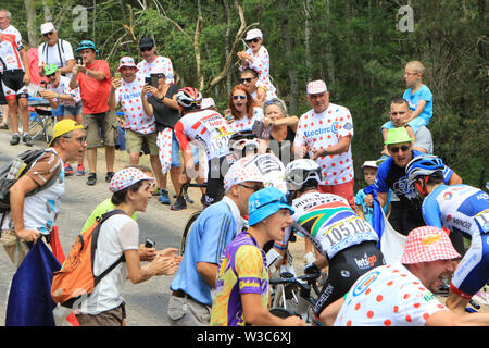 St Etienne, France. 14th July 2019. Tour de France Cycling tour, stage 9, Saint-Etienne to Brioude; Tiesj Benoot (BEL) Lotto Soudal and Anthony Delaplace (FRA) Team Arkea, Daryl Impey, Mitchelton - Scott at the Mur (Wall) d'Aurec-sur-Loire Credit: Action Plus Sports Images/Alamy Live News - Stock Image