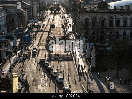 View from above to the Brandenburger Tor during opposite evening sunlight. Schlossbruecke and river Spree in the - Stock Image