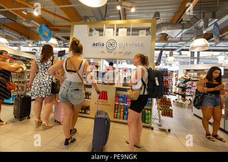 Young women shopping in the duty free shop, Bordeaux-Merignac airport, Bordeaux, France Europe - Stock Image