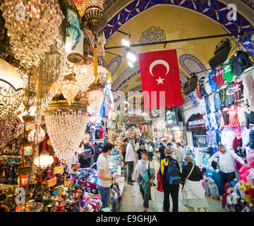 People shopping inside the Grand Bazaar in Istanbul - Stock Image