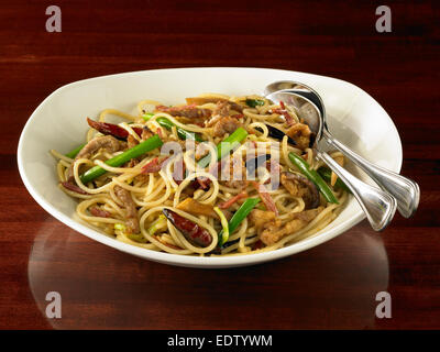 Spicy Pork and Fried Noodles - Stock Image