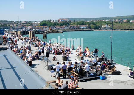 Summer entertainment on Folkestone Harbour Arm, Kent, UK - Stock Image