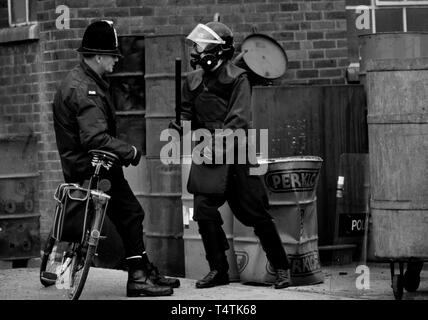 British Police armed with guns. 1986 Photographs from a series photographed in 1986 showing the arming of the British Police, traditionally at the time not armed. Gun dealer in the west country of the UK shows his weapons for sale to a real local policeman on a bicycle. - Stock Image