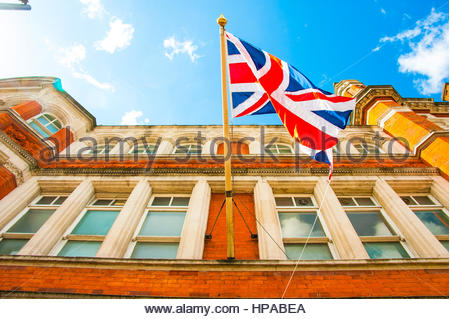 Union Jack flying outside Leyton Technical the former grade 2 Town Hall In Leyton, London, UK Europe, which is now - Stock Image