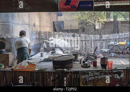 Man cooking food at the Nyaung U marketplace in Nyaung U, near Bagan Myanmar (Burma) - Stock Image
