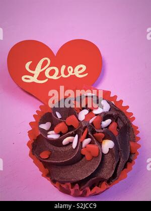 Chocolate Love themed cup cake with Love heart. - Stock Image