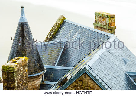 Views & sites around the town and Island of Mont St Michel on a cloudy & wet day in Normandy, France. Roof, - Stock Image