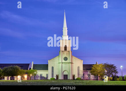 Young Meadows Presbyterian Church, a christian denomination, at dusk and at night, in Montgomery Alabama, USA. - Stock Image