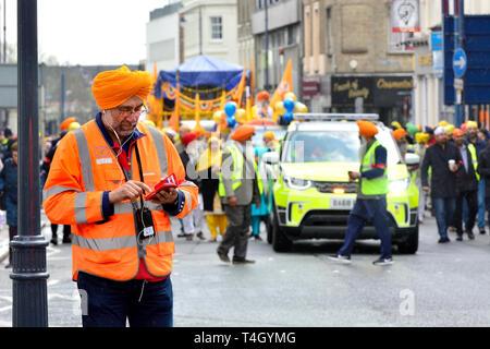 Gravesend, Kent, UK. Vaisakhi (or Baisakhi / Vaishakhi / Vasakhi) annual Sikh festival celebrating the Punjabi New Year. 13th April 2019. Marshals... - Stock Image