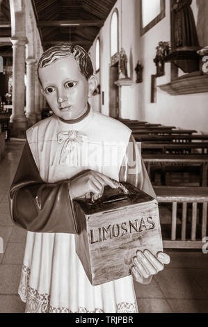 Limosnas (charity, Alms, donations) box in church in Spain. - Stock Image