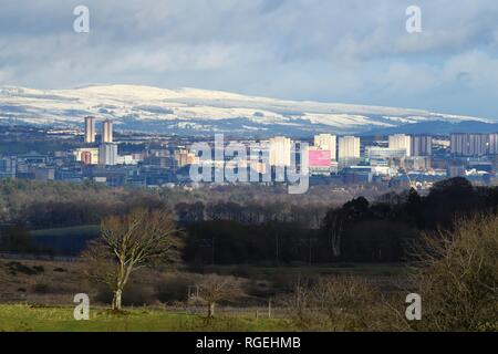 Glasgow, Scotland, UK, Europe. Snow fell in the Glasgow area but it's in the hills surrounding the city which was worst affected. Here the Campsie Fells are white with snow, sitting behind the city centre. Credit: Douglas Carr/Alamy Live News  - Stock Image