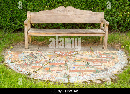 A year 2000 millennium bench and semicircular mosaic in Fryton, North Yorkshire, England, UK - Stock Image