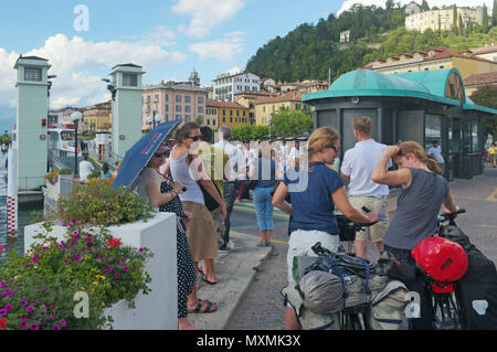 tourists by the pier, Bellagio, Lake of Como, Italy - Stock Image