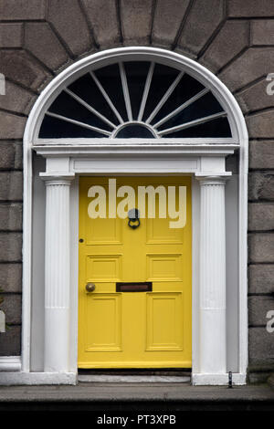 One of the famous Dublin doors. Typical of the design of many front doors in central Dublin. Republic of Ireland. They are often painted bright colors - Stock Image
