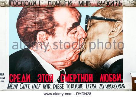 Painting by Russian artist Dimitry Vrubel of Brezhnev kissing Honecker on the Berlin Wall, East Side Gallery, Friedrichshain, Berlin, Germany - Stock Image
