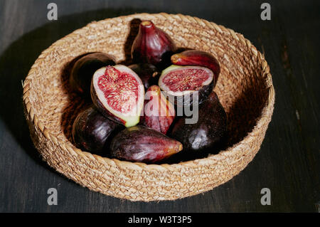 figs isolated on a handmade basket - Stock Image