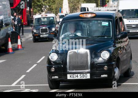 UK taxi in London street - Stock Image