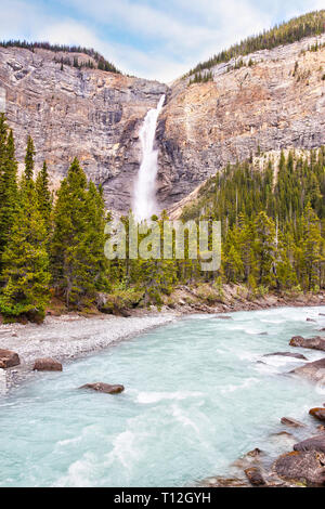 Powerful Takakkaw Falls in Yoho National Park near Field, British Columbia, Canada, with its glacier-fed emerald colored waters flowing into the Kicki - Stock Image