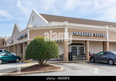 GREENSBORO, NC, USA-2/14/19: A Starbucks Coffee shop in Guilford College shopping center. - Stock Image