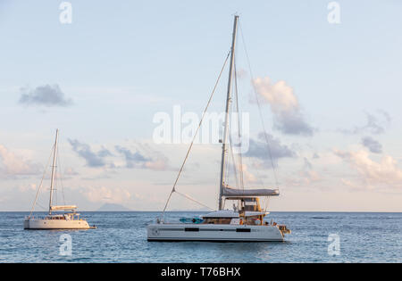 Two sail boats just of Shell Beach in St Barts - Stock Image
