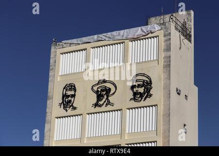 Metal Faces of Fidel Castro, Ernesto Che Guevara and Camilo Cienfuegos on Building Wall Mural near Revolution Museum in old Havana, Cuba - Stock Image