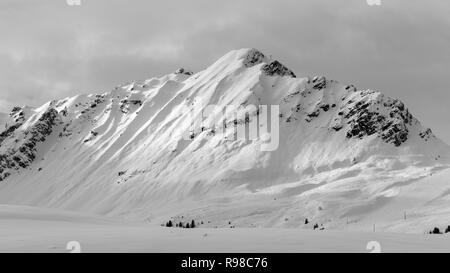Mountains in black and white, taken in Courchevel, snow, winter, ski resort in the French alps, Les 3 Vallees, 3 Valleys ski area in France - Stock Image