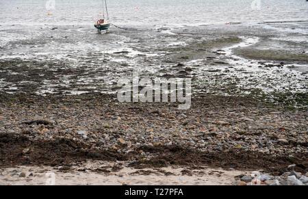 Lindisfarne or Holy Island, Northumberland coast south of Berwick-on-Tweed, England. Beach with boat. - Stock Image