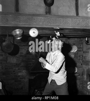 Comedian Richard Heane tossing a pancake on Shrove Tuesday 1951. February 1951 B608-002 - Stock Image