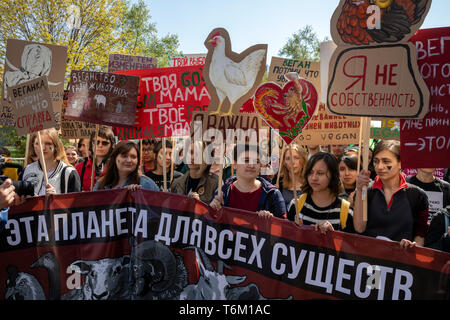 Vegan procession participants hold posters calling for not eating animals in Moscow, Russia - Stock Image