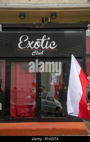 Polish flag and an exotic club during Polish Independence day on 11 November 2018 in Warsaw Poland - Stock Image