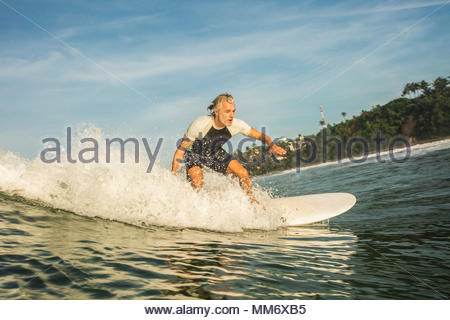 Man surfboarding in the Indian ocean, Sri Lanka - Stock Image