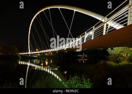 Self-supporting arched bridge over the Mulde near Dessau at night, Dessau-Roßlau, Saxony-Anhalt, Germany - Stock Image