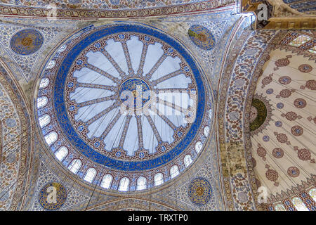 Ceiling inside the Blue Mosque in Sultanahmet, Istanbul, Turkey. More than 32 million tourists visit Turkey each year. - Stock Image