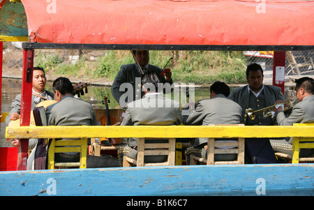 Mariachi Band on a Boat on the Canals of the Floating Gardens of Xochimilco, Mexico City - Stock Image