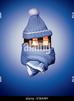 A detached house wearing a bobble hat and scarf - Stock Image
