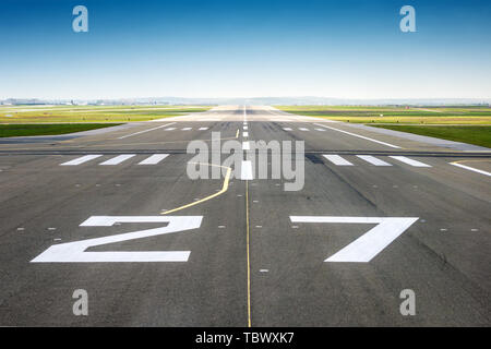 vanishing point of view from an airport track, blue sky background - Stock Image
