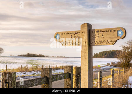 A wooden South Downs Way direction sign in the South Downs during winter, South Downs in Hampshire, England, UK - Stock Image