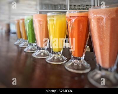 Smoothie and Fresh Juices in juice bar cafe in Mexico on counter. - Stock Image