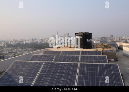 Sollar panel seen of a building rooftop in Dhaka, Bangladesh, January 31, 2019. © Rehman Asad / Alamy Stock Photo - Stock Image