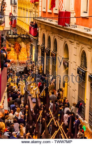 A paso (float) of the Virgin Mary in the procession of the Brotherhood (Hermandad) El Buen Fin, Holy Week (Semana Santa), Seville, Andalusia, Spain. - Stock Image
