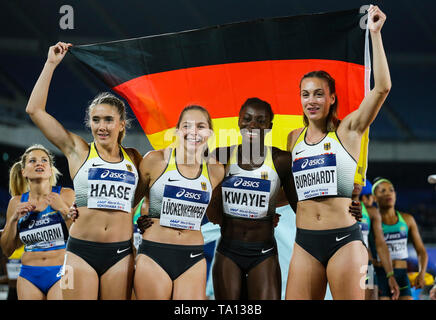 YOKOHAMA, JAPAN - MAY 12: Rebecca Haase, Gina Lückenkemper, Lisa Marie Kwayie and Alexandra Burghardt of Germany after they finished 3rd in the women's 4x100m relay final during Day 2 of the 2019 IAAF World Relay Championships at the Nissan Stadium on Sunday May 12, 2019 in Yokohama, Japan. (Photo by Roger Sedres for the IAAF) - Stock Image