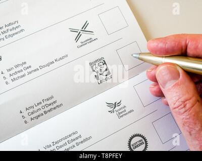 Man voting on ballot paper for Scottish Labour party in European Parliament election, Scotland, May 2019 - Stock Image