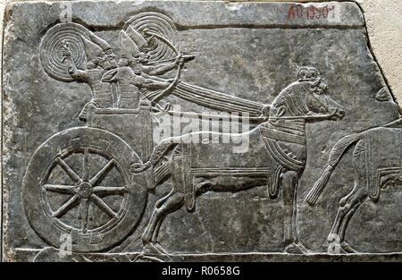 1379. ASSYRIAN WAR CHARRIOT IN BATTLE, RELIEF FROM SANAHERIB'S PALACE IN NINVEH, C. 700 B.C. 'The snorting of his horses was heard from Dan, the whole land trembled at the sound of the neighing of his stron ones, for they are come and have devoured the land and all that is in it...' JEREMIAH 8:16 - Stock Image